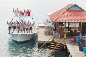 Divi Dive Boats Group Shot by Pier